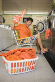 Portrait of man with team spirit at laundromat — Stock Photo