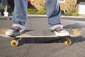 Low section of teenagers on skateboards — Stock Photo