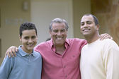 Three generations of men standing together — Stock Photo