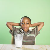 Portrait of African boy with glass of milk — Stock Photo