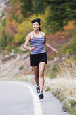 Female athlete jogging — Stock Photo