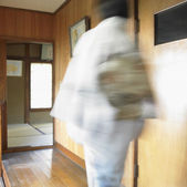 Blurred image of Asian woman walking — Stock Photo