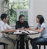 College students doing homework together — Stock Photo