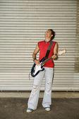 Young man playing guitar — Stock Photo