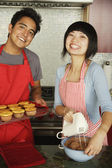 Couple baking together in kitchen — Stock Photo