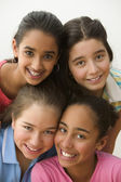 Close up portrait of four girls smiling — Stock Photo
