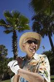 Senior man with golf club outdoors — Stock Photo
