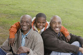 African American family smiling outdoors — Stock Photo