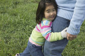 Young girl hugging grandfather — Stock Photo