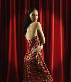 Young woman wearing long dress — Stock Photo
