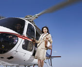 Asian businesswoman on helicopter — Stock Photo