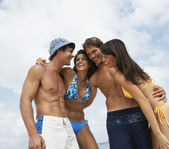 South American friends hugging at beach — Stock Photo