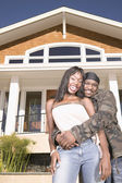 Portrait of couple in front of house — Stock Photo