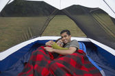 Portrait of Indian couple hugging in tent — Stock Photo
