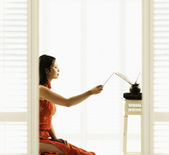 Profile of woman with incense — Stock Photo
