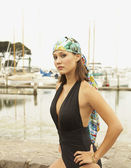 Asian woman wearing bathing suit at marina — Stock Photo