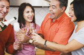 Middle-aged friends toasting with champagne — Stock Photo