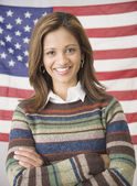 Indian woman in front of American flag — Stock Photo
