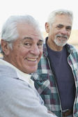 Two senior men smiling outdoors — Stock Photo