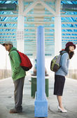 Two young adults waiting for train — Stock Photo