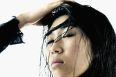 Young woman with her hand on her head — Stock Photo