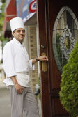 Chef walking into a restaurant — Stock Photo