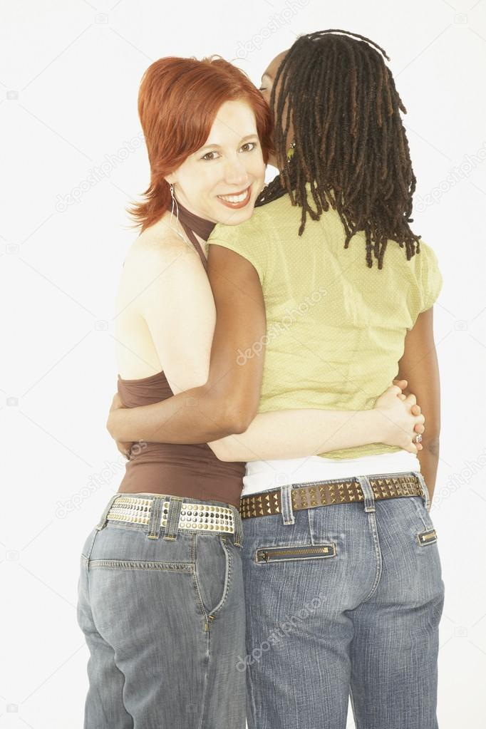 Studio shot of female couple hugging — Stock Photo #13233361