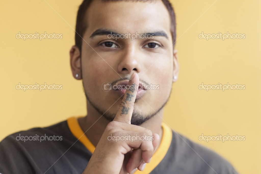 Young man making 'shh' sound — Stock Photo #13234315