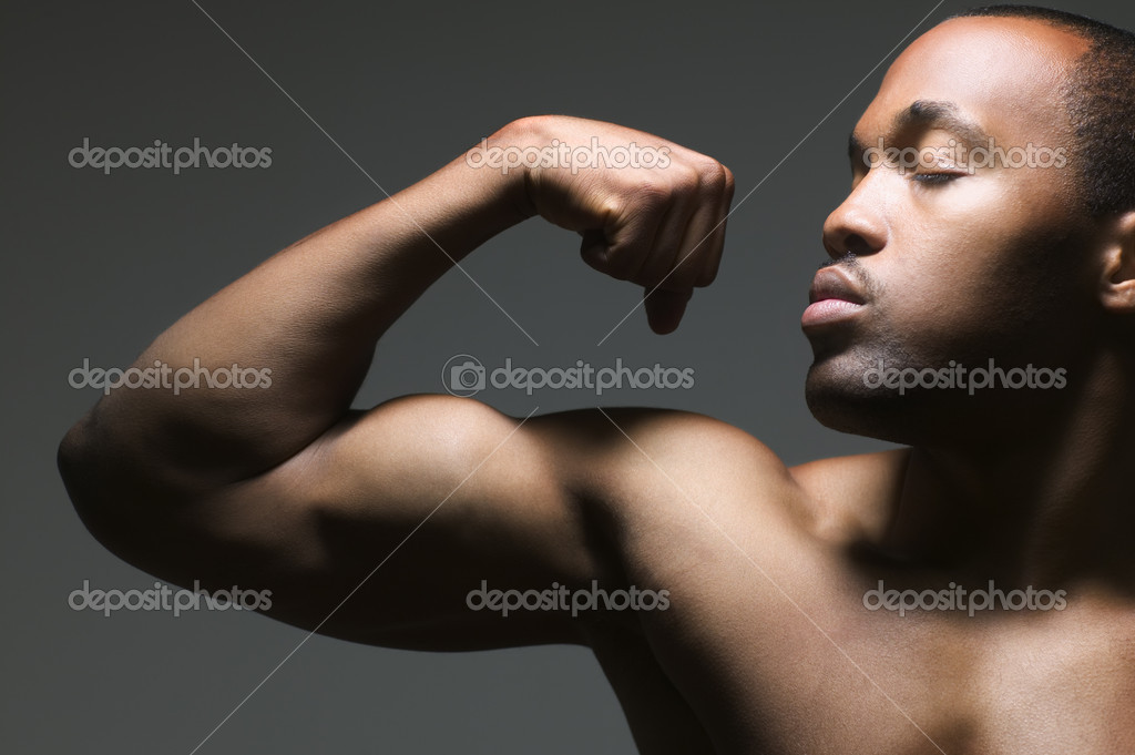 Close up of man flexing bicep — Stock Photo #13234569