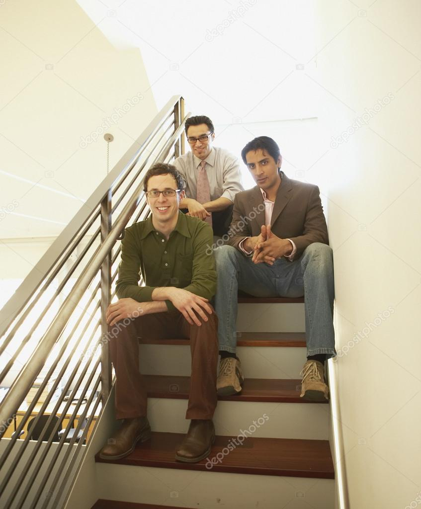 Businessmen sitting on a staircase — Stock Photo #13234793