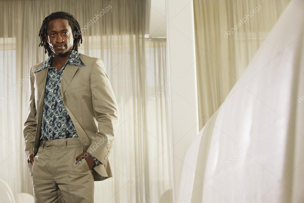 Portrait of African man with hands in pockets — Stockfoto #13234912