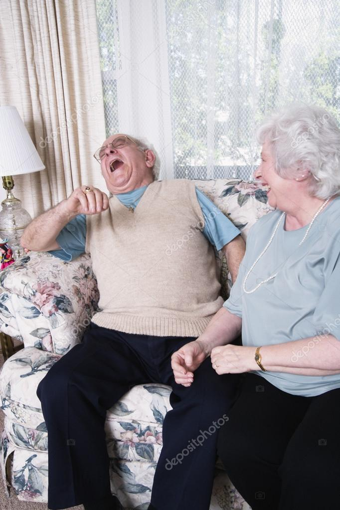 Senior couple laughing together — Stok fotoğraf #13235134