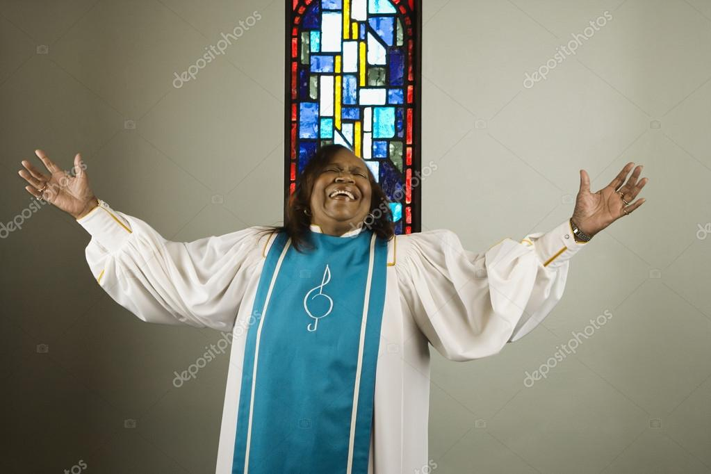 African woman wearing church choir gown and singing — Stock Photo #13235725