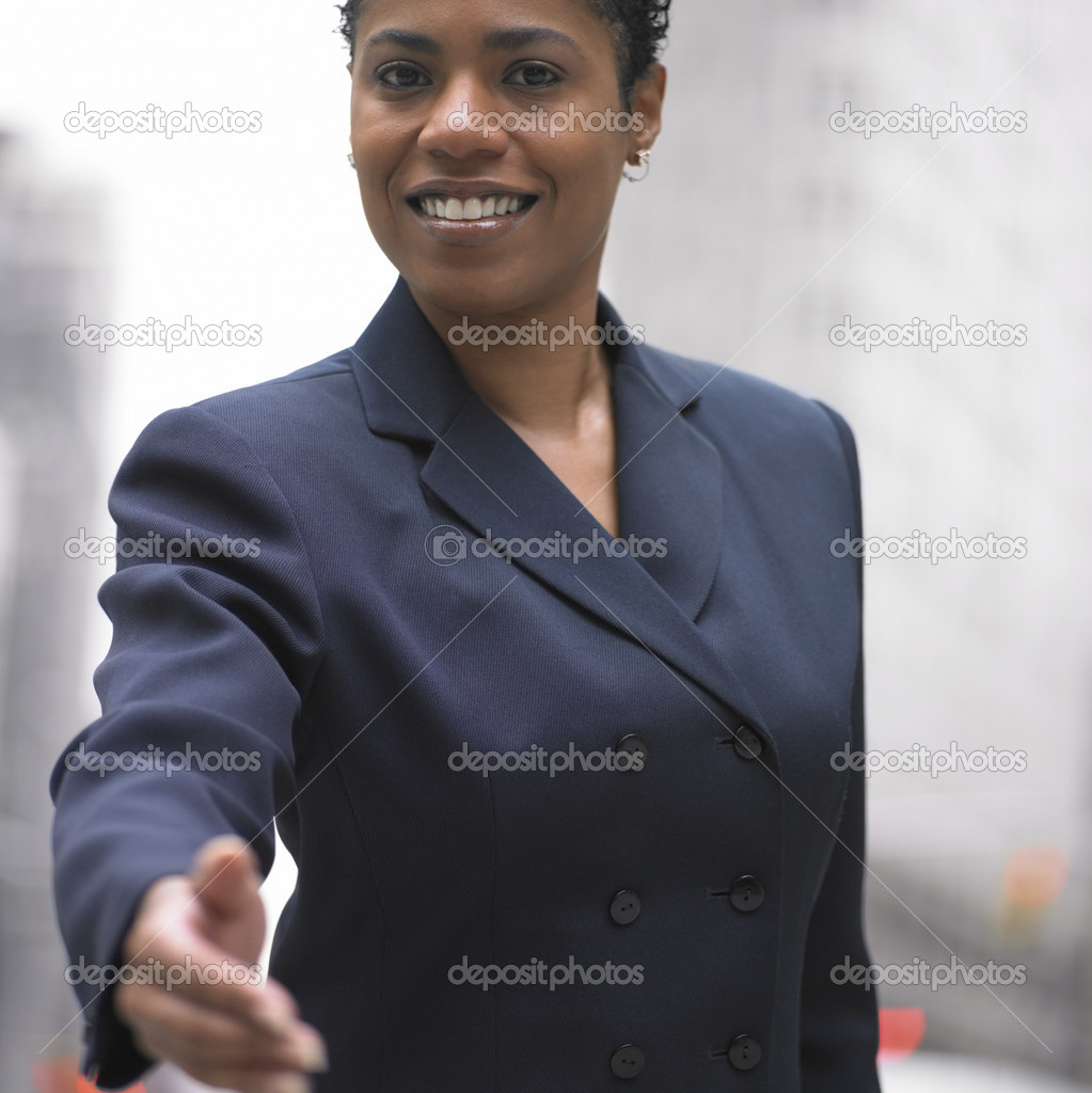 Businesswoman extending hand — Stock Photo #13235941
