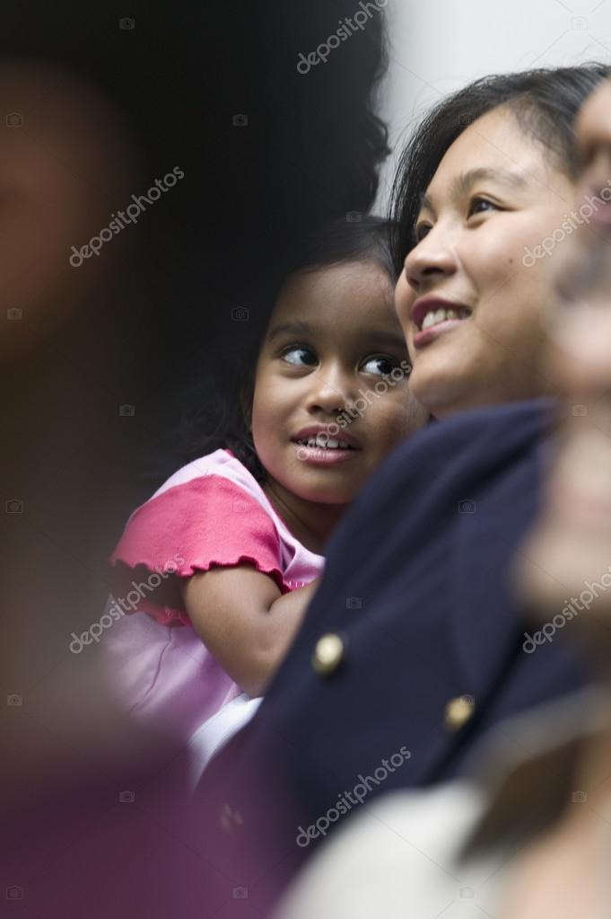 Mid adult woman holding a young girl — Stock Photo #13236258
