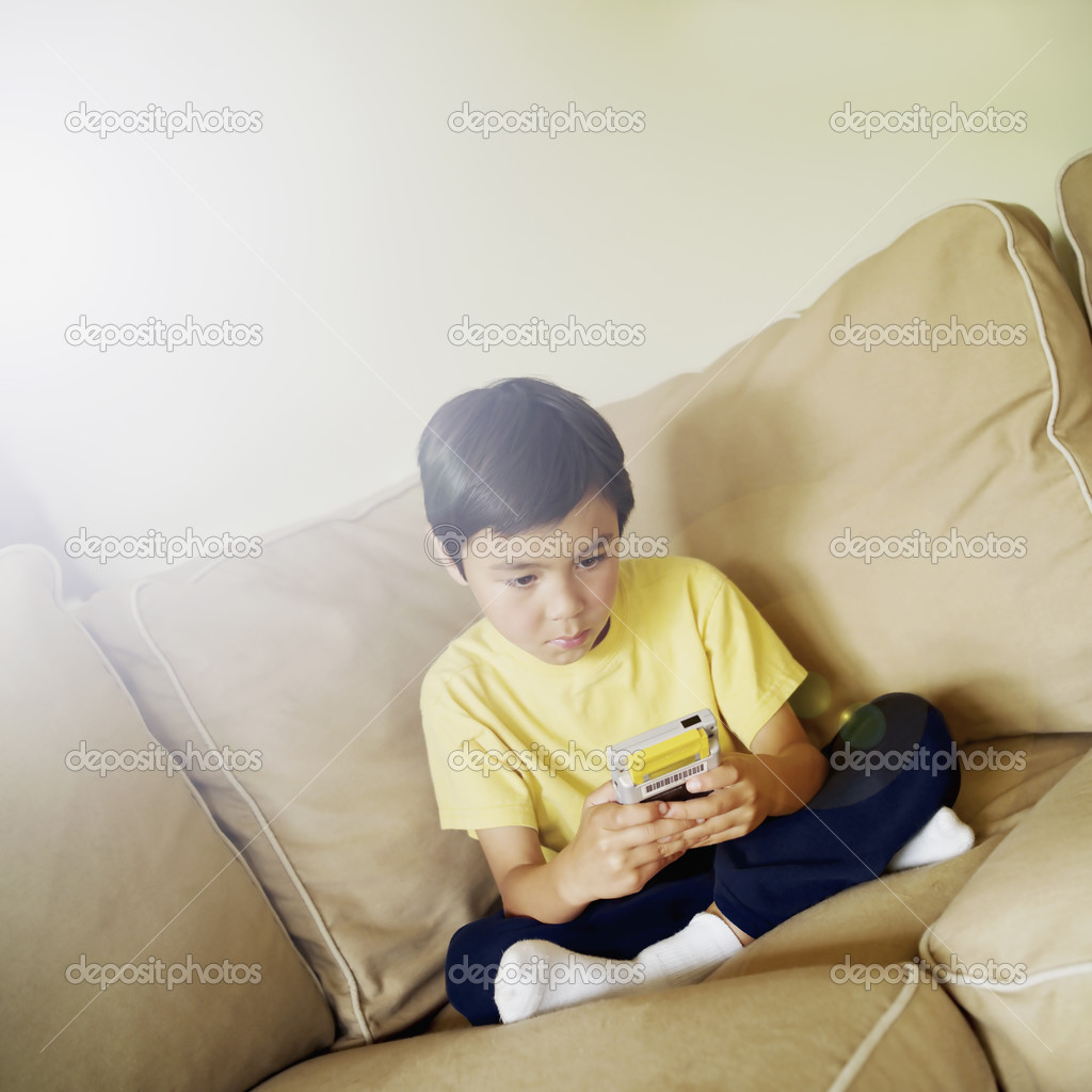 Boy playing hand held video game — Stock Photo #13237887