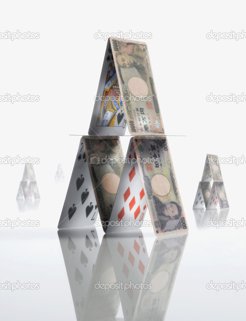 Pyramid made of  Yen and playing cards — Stock Photo #13238335