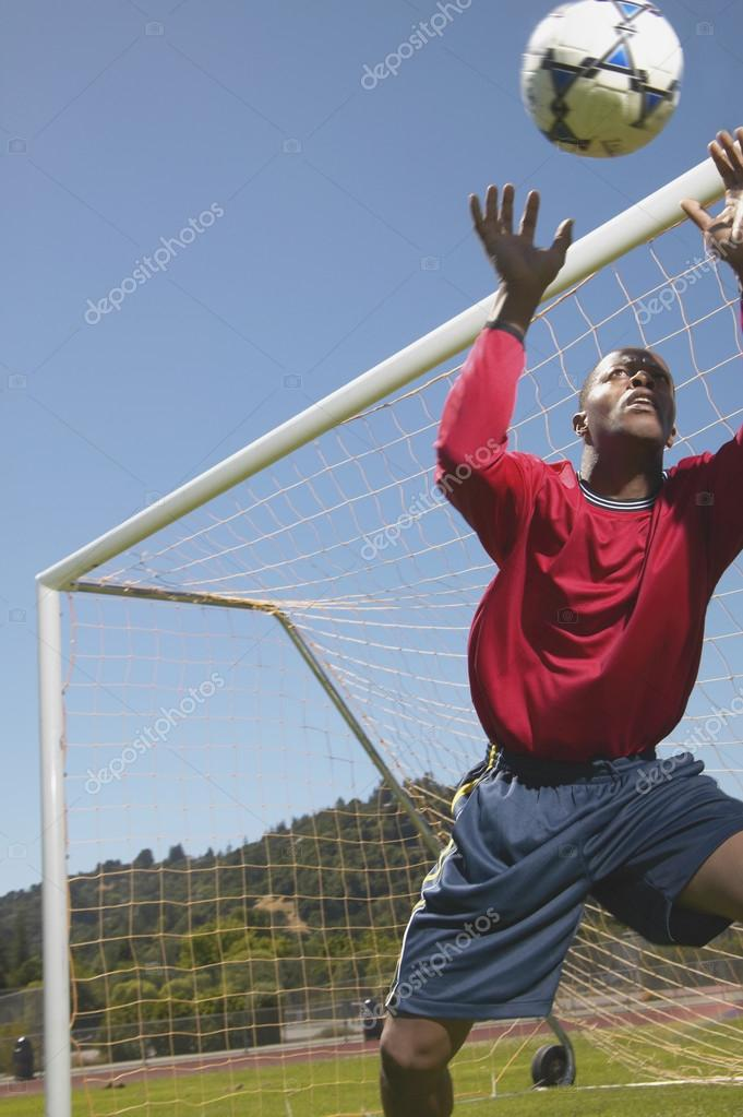 Goalie stopping ball in soccer game  Foto de Stock   #13239152