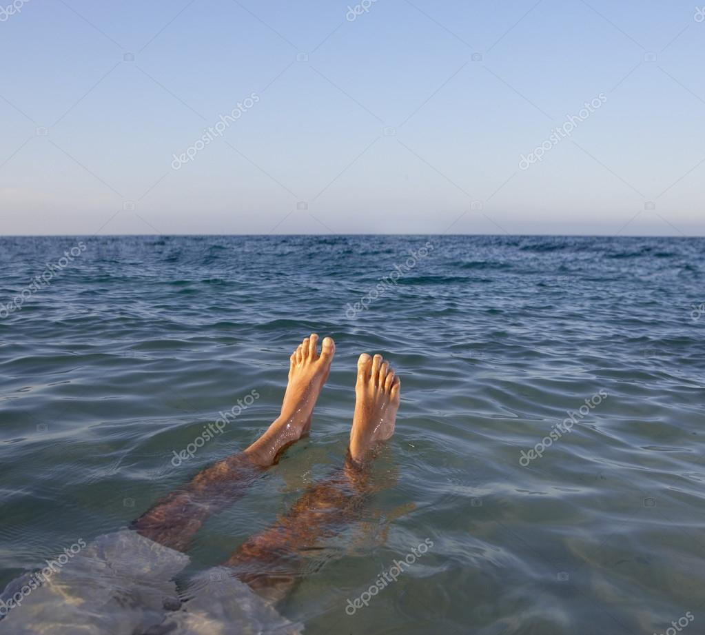 Young man floating in the ocean  Foto Stock #13239534