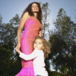 Mother and daughter dancing outdoors — Stock Photo #13240011