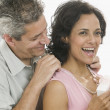 Mgiving necklace to woman — Stock Photo #13240031