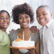 Stock Photo: African American mother and children with birthday cake