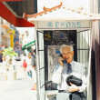 Stock Photo: Senior min phone booth