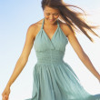Stockfoto: Womholding out dress to sides