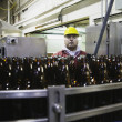 Man working in bottling plant — Stock Photo