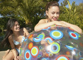 Two women with beach ball — Stock Photo