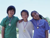 Group portrait of children wearing metals — Stock Photo