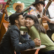 Young couple with Mariachi band - Stock Photo