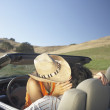 Couple kissing in convertible — Stock Photo