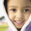 Portrait of young girl in parka smiling — Stock Photo